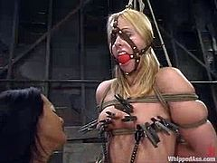Sexy blonde girl gets her vagina tortured with claws by Sandra Romain. Later on she also gets her tits clothespinned and pussy toyed rough.