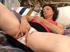 Have a blast watching this mature lady, with big knockers wearing a long skirt, while she touches herself till she reaches an orgasm!