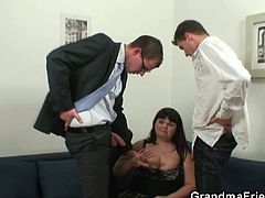 This horny granny plumper is ready for some hardcore action with two younger dudes. One is penetrating her old fat cunt, while she keeps on sucking on a cock.