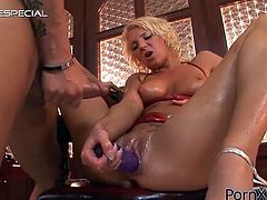 Make sure you get a load of this hardcore scene where this horny blonde babe has her holes drilled by this guy's dildo before she's fucked.