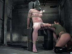 This mistress has put a bag on this guy's head and ties him up in rope. She plays with his tiny cock and tries to get in hard. It's not use his limp dick can't get an erection even when she kisses his cock head.