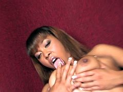 She is strips and rubs her tight shaved cunt and then cock comes out from hole. First she sucks it and then put that rod in her wet pussy.