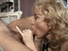 Shapely blonde sexpot in black stockings gives her man a nice blowjob
