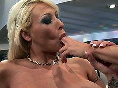 Blonde lesbians stimulating one another