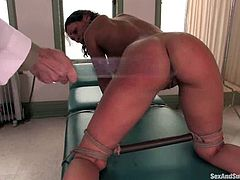 Charley Chase is playing dirty games with doctor Steve Holmes in his office. Steve binds Charley, plays with her pussy and toys it and then pounds it deep and hard from behind.