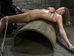 She loves playing roles in BDSM and here is one with her! Honey is all oiled up and it makes her look so hot! But, once BDSM starts, babe gets fucked up!