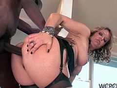 Kelly Leigh never misses an opportunity to deepthroat a big black dong. She does it like a pro and then takes it up her mature pussy!