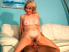 This mature woman loves it all. She rides this guy's dick then he lays her down on the couch and slams it in her still tight ass.