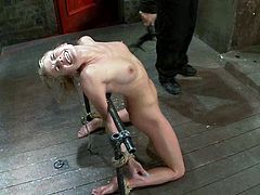 Pretty blonde girl gets tied up and whipped by her master. Then the guy fixes claws to her nipples and tortured the pussy with ropes.