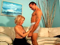 Hot blonde mom Erica Lauren is playing dirty games with some guy indoors. She sucks his long prick and then allows the stud to finger her hairy snatch and fuck it in cowgirl position.