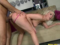 Have a blast watching this tattooed blonde, with a great ass wearing a fuchsia thong, while this dude bangs her in every hole she has!