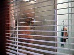 Hidden cam - Through window-Brunette shower