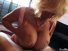 This old woman can give any man an instant erection just seeing her big pillowy tits and what a fine ass she has. Once she sees her lover's pecker curvaceous granny can't resist trying it out. She sucks his meat stick passionately. Then she pleases him with a titjob.