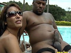 Take a look at this hardcore scene where the hot Brazilian babe Fernanda Lemos is nailed by this guy's big cock outdoors.