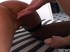 See two horny babes, one brunette and one blonde, going lesbo while sharing a hard black cock. Then see them fucking each other with a strap on cock while assuming very naughty poses.
