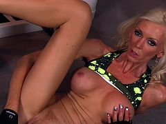 Big boobs blonde cougar shows off quite amazing in a nasty solo action