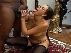 Nasty Milf gets her face covered in thick fuckin' jizz after gettin' nailed by a black dude, check it out right here! It's fuckin' awesome!