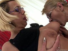 Two salacious grannies Milli and Beata A are having some good time together. They kiss and caress each other and then rub each other's cunts and fuck them with a dildo.