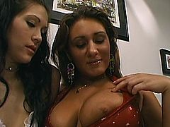 Two captivating chicks are having lesbian fun indoors. They kiss and caress each other and then eat each other's twats and pound them with a dildo.