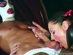 Curvaceous MILF is wearing tight latex mini dress that is tracing her tempting curves. She gets her ass hole fingered by perverted dude that is wearing facial mask. She then gives him deepthroat blowjob. After she is done sucking the rod she is fucked hard doggy style,