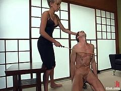 Nasty Audrey Leigh pinches guy's nipples with steel claws. After that she also whips him and gets her pussy licked. Later on she toys his ass with a strap-on.