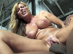 Slutty Nicole Moore stands on her knees and sucks big black cock. Then she takes her dress off and takes that huge cock in her shaved pussy.