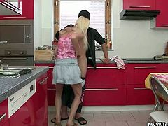 This horny blonde granny is ready finally to bang her son in law. She seduced him in the kitchen and after sucking on his meat she takes it deep into her old cunt.