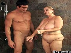 Masturbate watching this chubby blonde, with big nipples wearing fishnet tops, while she goes hardcore with a muscular guy in the bathroom.