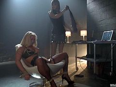Curvy blonde Holly Heart submits to Maitresse Madeline in a basement. Holly gets bound and whipped and then enjoys it when the mistress fucks her snatch with a strapon from behind.