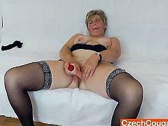 Watch this horny granny Berta in her nasty solo.Chubby blonde Berta is playing with her tits before putting a rubber dick in her snizzpod.She spreads her legs and shows you her big pussy while toying herself.