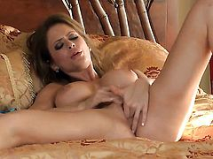 Emily Addison gives a closeup view of her beaver while masturbating with sex toy