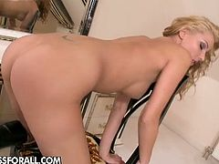 Cindy Hope is a blonde goddess. She is wearing sexy black boots when she touches her bald snatch and she keeps them on even when she starts toying her cunt.