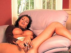 Dazzling Claudia Valentine amazes by smacking her pussy with a big toy