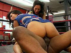 Check these two alluring Asian brunette belles giving a horny black dude a hell of a time in the ring. He can't wait to bang them while their munch their sweet pussies!