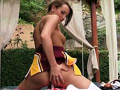 Jenna Rose is the cheerleader team captain and she is ready for some amazing solo action outdoors. Watch her spreading her legs wide and usin her fingers to rub herself.