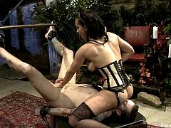 Brunette chick in latex forces a guy to suck a strap-on and gets her pussy licked. Later on she toys his ass and rides his cock.