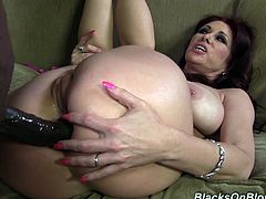 Make sure you have a look at this interracial video where the busty redhead Tiffany Mynx is nailed by this guy's large black cock.