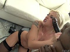 Curvy blonde Leya Falcon fucks two dudes' butts with a strapon