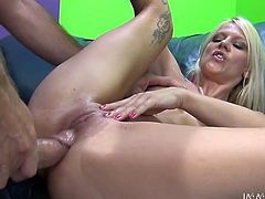 Sexy blonde Caroline De Jaie shows her beautiful natural tits to Travis Varjak and pleases him with a blowjob. Then she allows him to fuck her coochie from behind and in other positions.