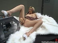 Curvaceous blonde girl in lingerie and high heels has real fun in her bedroom. She gets her vagina drilled by the fucking machine in different poses.