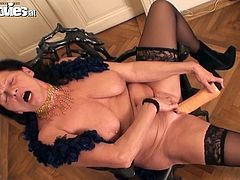 Take a look at this solo scene where this busty brunette granny pleases her wet pussy with a dildo as you take a look at her big natural tits.