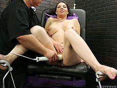 Brown-haired chick Kiki Daire sits on a chair with her legs spread wide. She lets some man rub her vag with a dildo and then enjoys a hot moment with a fucking machine.