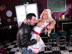 Wearing a sexy waitress costume blonde babe Jacky presents at work. She loves her job and works hard all day so some times this babe receives some tips. The tip she likes most comes from this guy and boy she enjoys it. the dude grabs her big hot boobs and licks them until she kneels for his dick