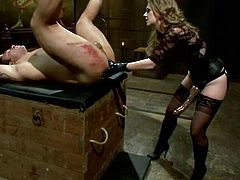 Dutch Bardoux is having fun with lewd milf Mistress T in a basement. He allows the bitch to beat his butt with a stick and then enjoys having her fist in his chocolate eye.