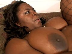 Very fat Black chick gives a blowjob standing on her knees. After that she gives a titjob and gets fucked hard on a sofa. She also gets facialed.