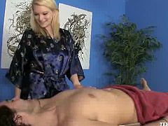 Amber Sativa is working as a masseuse. She's good at giving back massages, but she's even better at massaging balls and cock. She relaxes the dude and then she jerks him off.