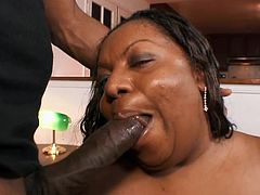 Extremely fat Black woman poses for a guy in stockings. She also gives him a blowjob standing on her knees. Later on she gets rammed in her vagina as well.
