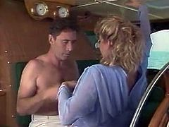 Blond head pretty looking bitch with nice Mamillas gives deep throat dick suck and energetically rides throbbing bonker on leather coach while yacht walk. Enjoy this sea fuck in The Classic Porn sex clip!