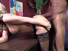 Get a load of this wild interracial threesome with the cock thirsty blonde milf Simone Sonay is double penetrated by two large black cocks.