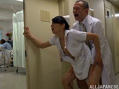 Take a look at this hardcore scene where a horny Asian nurse is fucked in the middle of the hallway by a doctor where anyone can spot them.